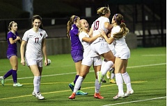 DAN BROOD - Sherwood seniors (from left) Daria Brandt, Kailen Fried, Lindsay Howard and Cameron Greene celebrate after the final whistle blows in Saturday's Class 6A state championship match. The Lady Bowmen beat Sunset 2-1.