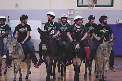 PHIL HAWKINS - Gervais Middle School eighth-graders and staff members clash on the court of the elementary school gymnasium on Thursday in an exhibition donkey basketball fundraiser.