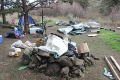 SUSAN MATHENY - Last week, the Jefferson County Sheriff's Office cleared out more than a dozen camps in the Willow Creek Canyon, below the trestle. One of the most elaborate homeless camps had a couch, multiple chairs, tent, mattress, fire pit with wood, cooler and bags of food, as well as a shopping cart for transportation.