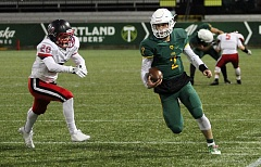 TIDINGS PHOTO: MILES VANCE - West Linn's Tim Tawa passed for 352 yards and three touchdowns to lead his team past Clackamas 41-20 at Providence Park in the Class 6A state semifinals on Friday.