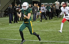 TIDINGS PHOTO: MILES VANCE - West Linn's Jake Meisen makes the second of his two touchdown catches during his team's 41-20 win over Clackamas in the Class 6A state semifinals at Providence Park on Friday.