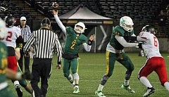 TIDINGS PHOTO: MILES VANCE - West Linn's Tim Tawa throws for some of his 352 yards during the Lions' 41-20 win over Clackamas in the Class 6A state semifinals at Providence Park on Friday.