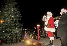 GRAPHIC FILE PHOTO - The big guest of the night is Santa Claus, who plans to arrive by way of a Tualatin Valley Fire & Rescue truck before he performs the highly-anticipated tree-lighting.