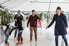 HILLSBORO TRIBUNE PHOTO: CHASE ALLGOOD - Folks skate on the ice rink at Winter Village at Orenco Station on Saturday, Dec. 3.