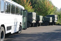 NEWS-TIMES FILE PHOTO: CHAE ALLGOOD - Military trucks line up outside the Forest Grove National Guard Armory prior to its closure in January 2015. It is scheduled to reopen next month.