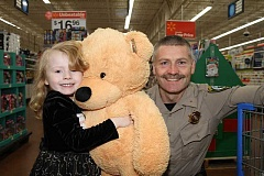 SUBMITTED PHOTO - About 150 Clackamas County children can shop with cops Saturday at the Clackamas Walmart.