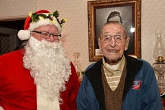 PHIL PASTERIS/TIGARD HISTORICAL ASSOCIATION - At the John Tigard House Victorian Christmas celebration, Santa Claus poses with 107-year-old Curtis Tigard, who is the nephew of John Tigard.