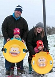 SPOKESMAN PHOTO: CLAIRE COLBY - The Varwig family braved the nippy weather to go catch a couple of runs on the snowy slopes of Memorial Park. Armed with emoji sleds, the girls sledded until they were red in the face from the cold.