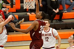 HILLSBORO TRIBUNE PHOTO: WADE EVANSON - Eric McKinstry goes up for a rebound during the Tide's loss at Beaverton.