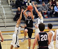 DAN BROOD - Sherwood High School senior John Sandilands (2) gets ready to go up to the basket during the Bowmen's win over Silverton on Saturday.
