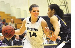 SETH GORDON - Freshman Madelynn Krotzer tries to get past a Bethesda defender during George Fox's 86-58 victory over Bethesda Dec. 22 at Miller Gymnasium. The Bruins will face No. 18 Trinity at 1 p.m. Thursday in the first of two road games this week in Texas.