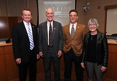 REVIEW PHOTO: VERN UYETAKE - Returning Councilor Skip ONeill (left) poses with Mayor Kent Studebaker and new Councilors John LaMotte and Theresa Kohlhoff at a reception before Tuesday's Lake Oswego City Council meeting.