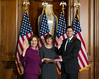 PHOTO COURTESY OF SUZANNE BONAMICI - U.S. Rep. Suzanne Bonamici, left, is sworn into the 115th Congress by Speaker of the House Paul Ryan. Her daughter, Sara Simon, holds the Bible.
