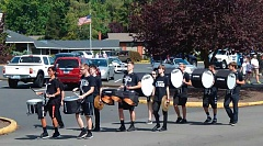 FILE - Members of the Tualatin High School Drum Line turned the 50th anniversary parade Aug. 13 into a festive event and drew residents out of their houses to view the parade as it moved through the city streets from the King City Clubhouse parking lot to King City Community Park.