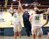 TIDINGS PHOTO: MILES VANCE - West Linn's Daria Ruediger (left) battles Lake Oswego's Kali Drango for a rebound during the Lions' 60-53 victory on Tuesday at West Linn High School.