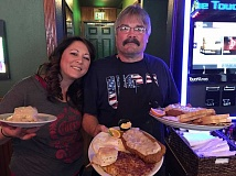 PHOTO BY LARRY SAWYER - Bartender Tracey Gatmin and chef Chuck Burt provide shelter from the storm at Broadway Saloon in Beaverton.