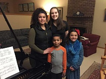 SUBMITTED PHOTO: BETH YAZHARI - Four young Lake Oswego singers will be among the participants in A Life of Service, a Martin Luther King Jr. Day musical celebration planned for Sunday, Jan. 15. From left: back row, Malaika Murphy, 15, and Julia Yazhari, 14; and front row, Jaden Yazhari, 7, and Zia Murphy, 9.