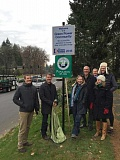 SUBMITTED PHOTO - City staff, councilors and PGE officials celebrated at the unveiling of a sign commemorating Lake Oswegos renewed green power certification in December 2015. It's just one example, officials say, of the City's eco-friendly policies and commitment to sustainability.