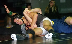 DAN BROOD - Sherwood High School junior Andrew Mabry is about to pin Canby's Harrison Kinney during their 145-pound natch at last week's Three Rivers League dual meet. The Cougars got a 47-21 victory.