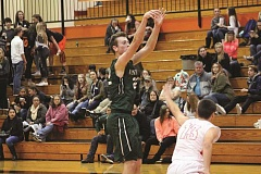 CONNER WILLIAMS - North Marion senior Tanner Scanlan erupted for 18 first-quarter points in the Huskies' 67-35 victory over the Molalla Indians on Jan. 10.