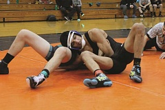 LESLIE ALVARADO - Woodburn's Giovanni Bravo holds an opponent in a double arm bar at the Snowmageddon wrestling tournament hosted by Molalla High School on Saturday. Bravo was one of 12 Woodburn wrestlers to finish with a top-four placement, taking third overall in the 132-pound bracket.
