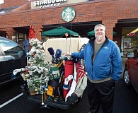 BARBARA SHERMAN - Jeff Grimes' golf cart was a mobile Christmas display complete with a Christmas tree over the holidays, which is one of his favorite times of year.