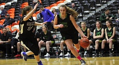 TIDINGS PHOTO: MILES VANCE - West Linn's Kennedy Fulcher drives to the basket during her team's 56-54 loss to Grant in the MLK Invitational at Lewis & Clark College on Monday.