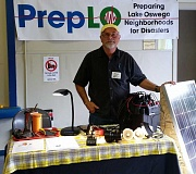 SUBMITTED PHOTO - PrepLO volunteer Ray Brown demonstrates a portable solar panel at the City's Emergency Preparedness Fair last April. Two upcoming events will feature similar information booths.