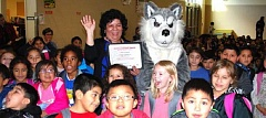SUBMITTED PHOTO - Evelyn Salvatierra, ESL assistant at Witch Hazel Elementary School, stands with students after she was nominated for the Hillsboro Chamber of Commerce's Crystal Apple awards.