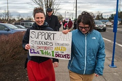 OUTLOOK PHOTO: JOSH KULLA - As the teachers stood in the cold, some supportive drivers honked and waved in encouragement.