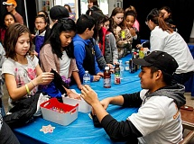 HILLSBORO TRIBUNE PHOTO: TRAVIS LOOSE - Century High School junior Nonilo Turiano shows visitors to his booth which drinks have more sugar.