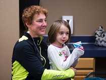 OUTLOOK PHOTO: JOSH KULLA - Anne Marshall, who attends the single mom's group, sits with her daughter before a recent meeting started.