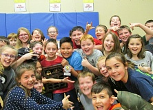 OUTLOOK PHOTO - Students from Mr. Bice's fourth-grade class gather to congratulate Aiden Gardiner, the winner of the East Orient Elementary School spelling bee.