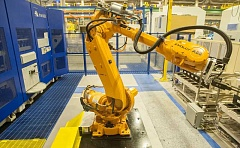 OUTLOOK FILE PHOTO: JOSH KULLA -  A Mandelli machine at Boeings plant in Gresham uses a robot to pluck the correct milling spindle and put them into place to fashion a wing component.