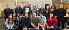 OUTLOOK PHOTO: JOSH KULLA - Some of CAL's students pose with teacher Chris Engstrom (holding check) and Chris Holden or KCR Manufacturing (left of Engstrom) and Derrick Warren of Selway Machine Tools.
