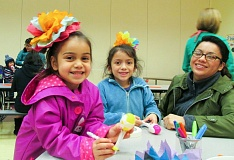 OUTLOOK PHOTO: TERESA CARSON - Alicia Gonzalez and two of her daughters made tissue paper flowers and the girls immediately put them in their hair at Hogan Cedars 'Celebrating Our Community' night.