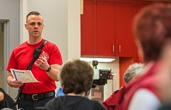 TIMES PHOTO: JONATHAN HOUSE - Capt. Patrick Fale of Tualatin Valley Fire & Rescue talks to seniors at the Juanita Pohl Center about spotting signs and symptoms of a heart attack Friday.