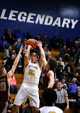 TRIBUNE PHOTO: JOANTHAN HOUSE - Jefferson High's Kamaka Hepa shoots against Willamette during a first-round state playoff game Tuesday night at Jeff.