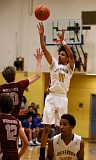 TRIBUNE PHOTO: JONATHAN HOUSE - Jefferson's Geno West hits for 3.