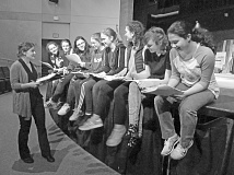 PHOTO BY ELLEN SPITALERI - Assistant director Brianna Norris, left, works with a group of young women in 'Midsummer/Jersey,' rehearsing them for a musical number that they will perform in the show.