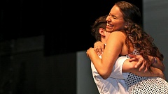 PHOTO BY JAMES G. HILL - Actress Jade Tate, a Southridge High School alumna, is embraced by Congeyer.
