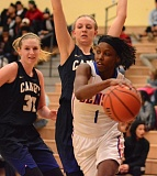 PAMPLIN MEDIA GROUP: DAVID BALL - Benson Tech's Zahaira Ahmed tries to work the ball around the Canby defense during a Class 6A girls basketball playoff game Wednesday night.