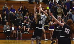 TIMES PHOTO: MATT SINGLEDECKER - Sunset junior Delaney Ragan tries to get up a shot against Lake Oswego in the first round of the Class 6A playoffs.