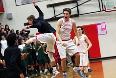 DAN BROOD - Westview seniors Zach Sly (55) and Trevor Laakso celebrate following the Wildcats' 49-46 win over Tigard in Friday's state playoff game.