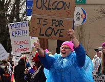 REVIEW PHOTO: VERN UYETAKE - Abby Farber of West Linn responds to support from passing drivers on State Street during Saturday's rally.