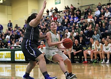 PMG PHOTO: MILES VANCE - West Linn junior Kennedi Byram goes to the basket during her team's 59-55 home loss to St. Mary's in the second round of the Class 6A state playoffs on Saturday.