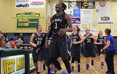 PMG PHOTO: MILES VANCE - St. Mary's senior Bendu Yeaney leaps into the air at the end of her team's 59-55 win at West Linn in the second round of the Class 6A state playoffs on Saturday.