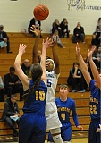 PAMPLIN MEDIA GROUP: SETH GORDON - Khiarica Rasheed of Grant High goes for a jump shot in a playoff victory over Newberg.