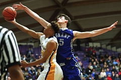 TRIBUNE PHOTO: JAIME VALDEZ - Kevin Samore of Grant High goes to block a shot by Jefferson's Kamaka Hepa during Wednesday's Class 6A boys quarterfinal at Chiles Center.
