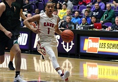 PMG PHOTO: JIM BESEDA - Clackamas senior guard Elijah Gonzales and the Cavaliers beat West Salem in their tournament opener and will face West Linn in the semifinals at 3:15 p.m. Friday at the Chiles Center.